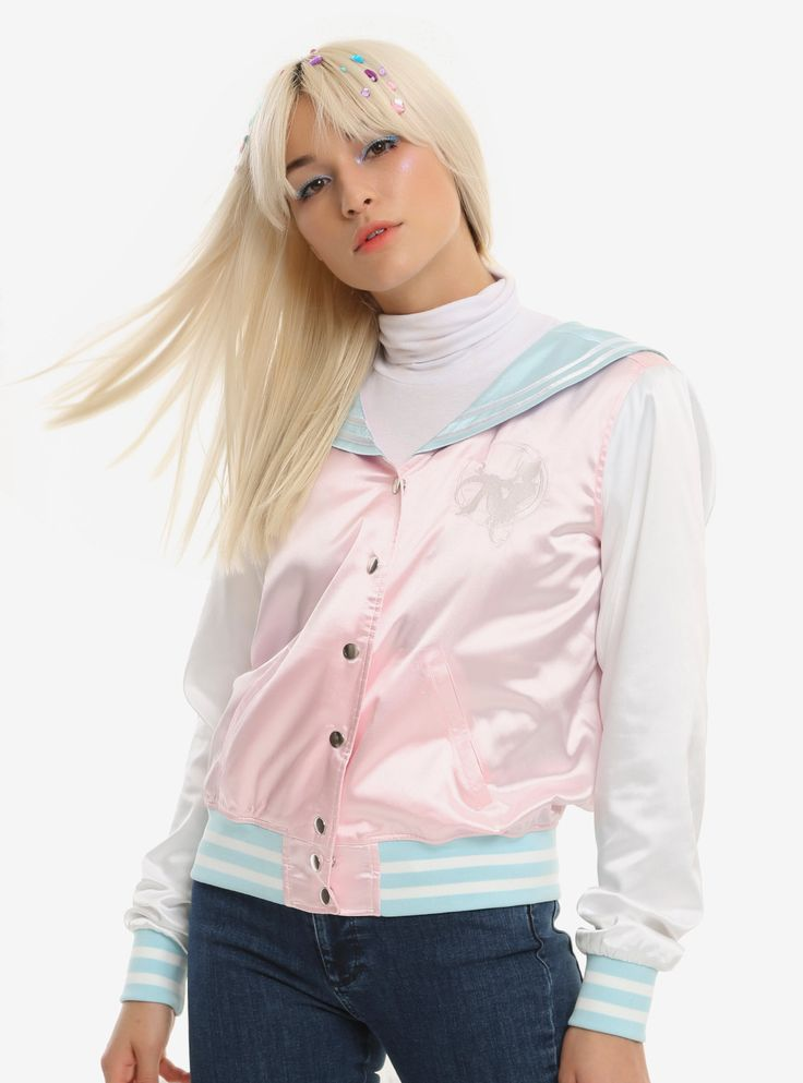Moon Prism Power! Make up!  Transform into the most stylish Sailor Guardian by wearing this satin souvenir jacket from  Sailor Moon . Let's start with the basics: it has a light pink body, white sleeves, light blue sailor collar and trim and two pockets. Details include an embroidered Sailor Moon silhouette on the left chest and embroidered Transformation Brooch on the back. And our favorite part: quilted pastel bubble lining - just like the background when Sailor Moon transforms!   Model...