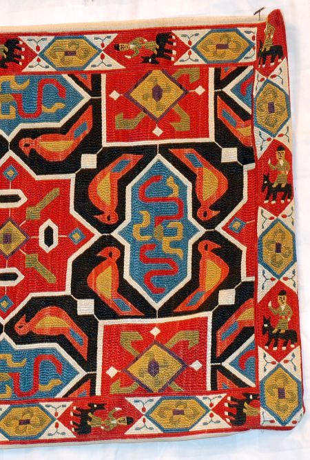 (detaila) a small, contemporary, cushion cover produced by a known dealer in Istanbul who is doing remarkable work.  The way in which the silk in these pieces takes dye is astounding.