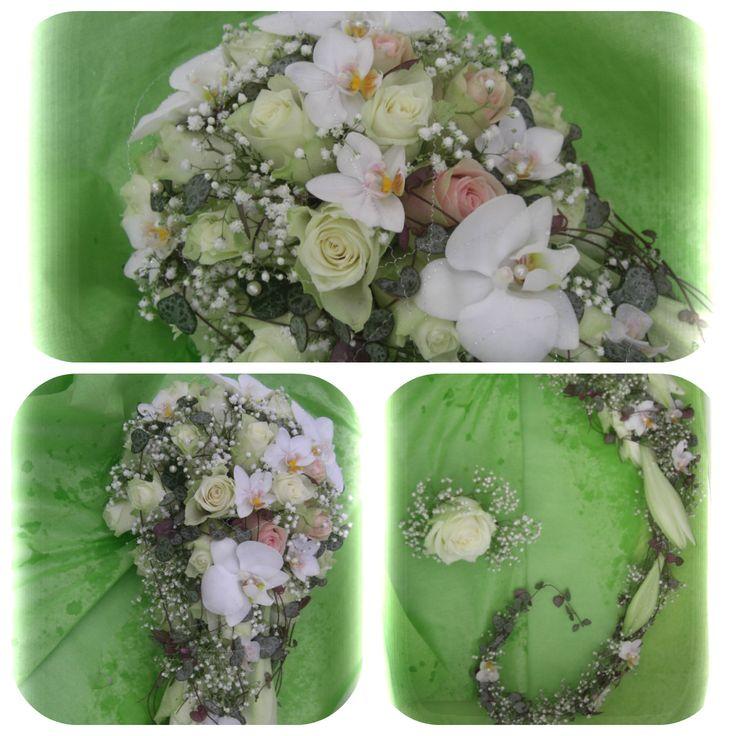 Lang dråpebukett med hovedsaklig roser, orchidè, brudeslør og hjerteranke.