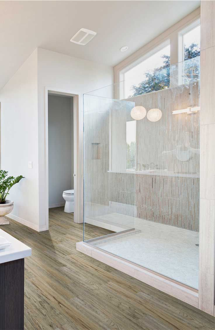 Modern bathroom. Floors by Beaulieu Canada, Dione from the Titans collection