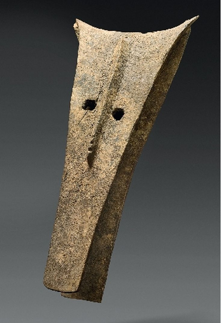 Africa | Kono mask from the Bamana people of Mali | Wood; of stylized zoomorphic form with long rectangular open snout, one pierced eye of rectangular form, the other circular, a ridge between the eyes with serrated section at the base, dark encrusted sacrificial patina