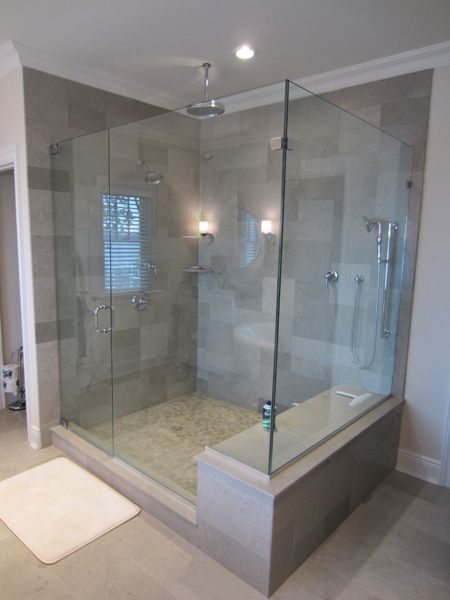 large shower with bench artistic tile