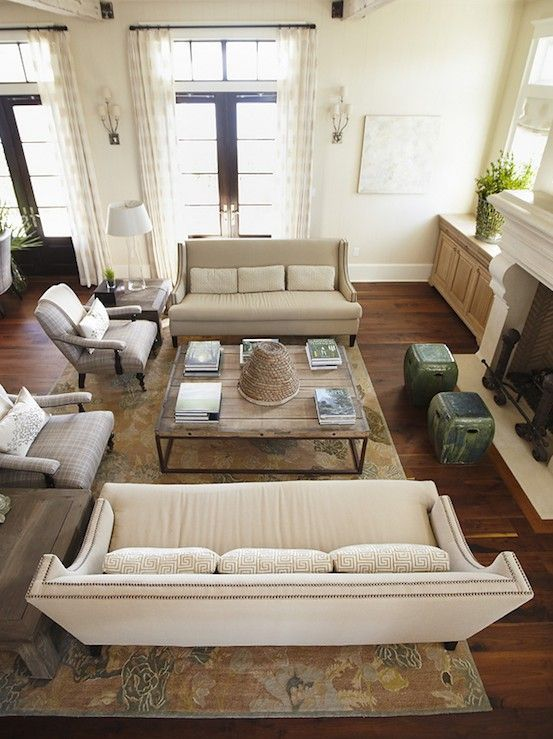 Why you should arrange two identical sofas opposite of for Small living room arrangements with tv and fireplace