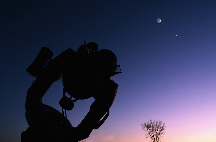 Telescope looking up at the Moon and Venus over Ontario, Canada.