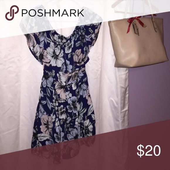 Floral zip up romper Dark blue romper with light blue pink and white floral designs. Zips up in back Charlotte Russe Other