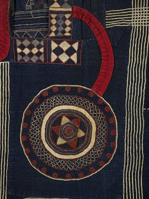 artafrica:  Kusaibi gown made from 14 narrow strips of cotton hand-woven on a narrow loom and dyed indigo; hand sewn together