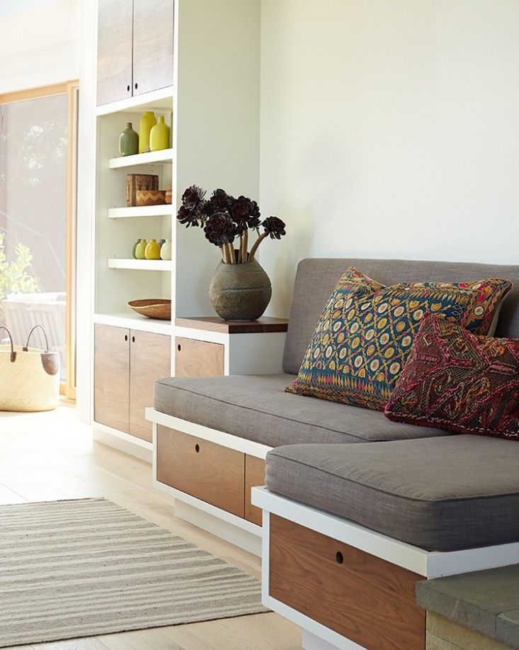 Built in seating with storage drawers with round cut out. CKD Mill Valley Kitchen | Remodelista
