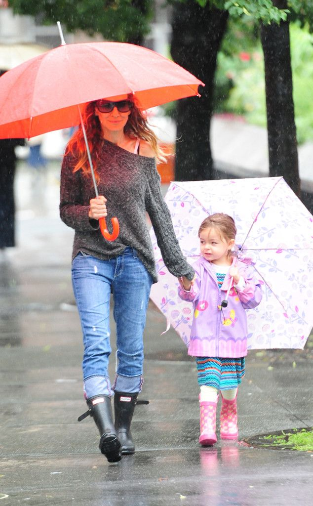 Rain Warriors from Celebrity Street Style  In a slouchy knit sweater paired with jeans and Hunter boots, Sarah Jessica Parker guides her umbrella-toting cutie through the rain in New York City.