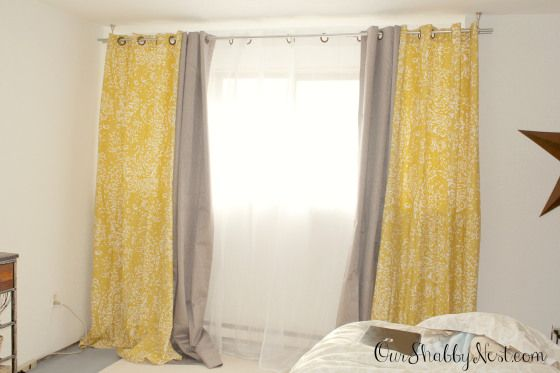 Super cheap 9ft or 10ft long double curtain rod set!!! Use conduit pipes from Home Depot that are $2.44 each! Yellow and gray bedroom colors, yellow and grey... Awesome cheap home decor ideas, tips and tricks via ourshabbynest.com
