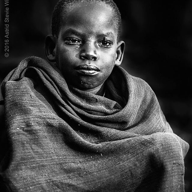 Faraway stare .... Portrait of a junior cattle herder at an early morning cattle ceremony ...