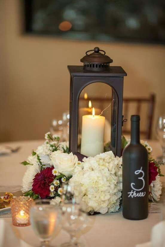 Love the flowers surrounding the lantern centerpiece