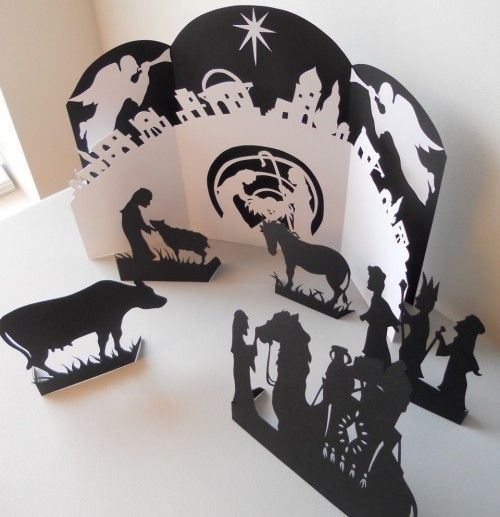 Nativity scene. Kathryn Carr presents her delightful portfolio of images, cut from paper in the scherenschnitte technique. Her website has more of her work.