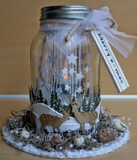 Glass jar decorated by DT member Astrid with Craftables Tiny's Pinetrees (CR1287), Tiny's Deer (CR1289) and Falling Stars (CR1294) by Marianne Design: