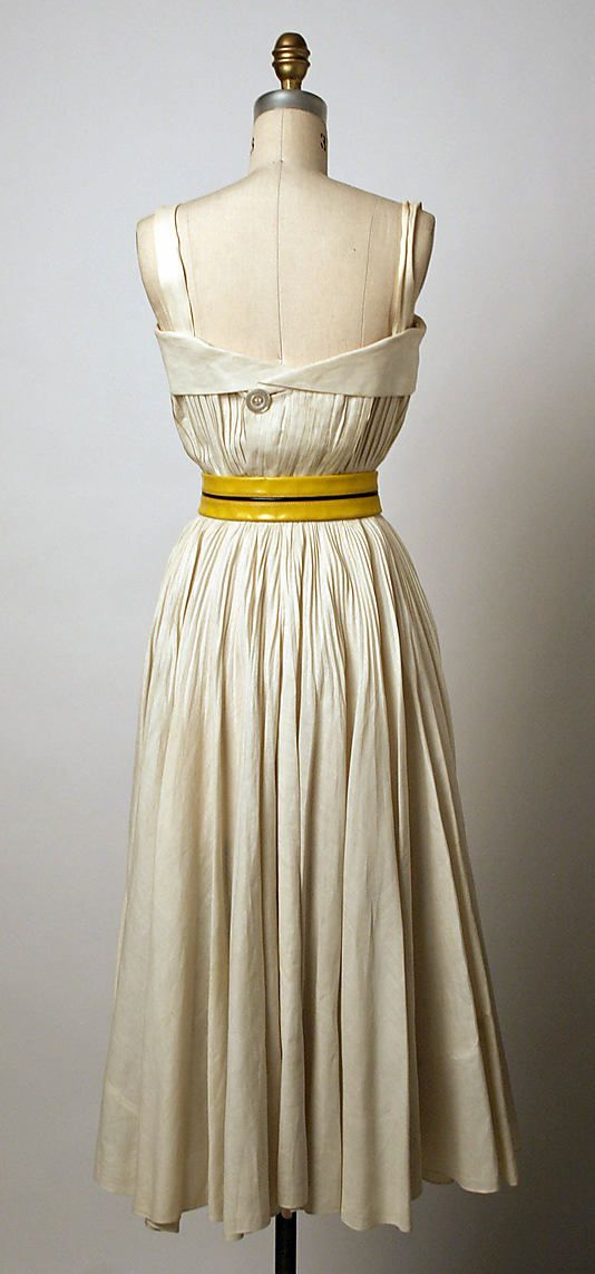 Dress.  Elsa Schiaparelli (Italian, 1890–1973).  Date: spring/summer 1951. Culture: French. Medium: linen, leather. Dimensions: (a) Length (side front): 46 in. (116.8 cm). (b) Length at CB: 33 1/2 in. (85.1 cm). (c) Length: 27 1/4 in. (69.2 cm).