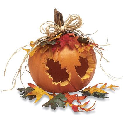 Different idea of carving the pumpkin.Trace a leaf shape onto the shell of a hollowed-out pumpkin, carve, decorate.*()