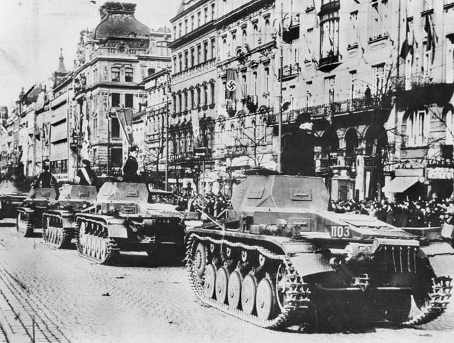 The betrayal of Czechoslovakia and later Eastern Europe originated with a misguided notion of peace on the part of British Prime Minister Neville Chamberlain and other Western diplomats. In this photo, German armored vehicles roll through the streets of a Czech city a mere six months after the signing of the infamous Munich agreement. Hitler's army marched into Prague without firing a shot.
