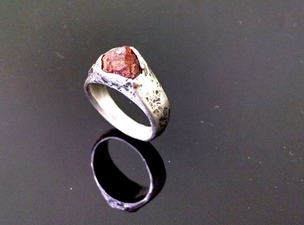 Rough garnet crystal set in custom rustic ring.  Made from recycled sterling silver. Get your custom rings at www.vivace.co
