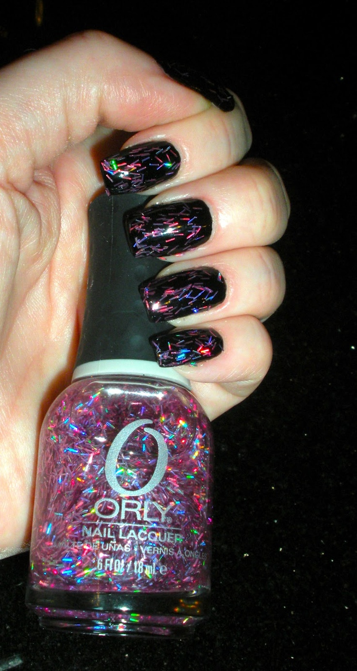 Orly's Be Brave, 1 mani above actual bottle. Clear base with pink holographic bar glitter, $6