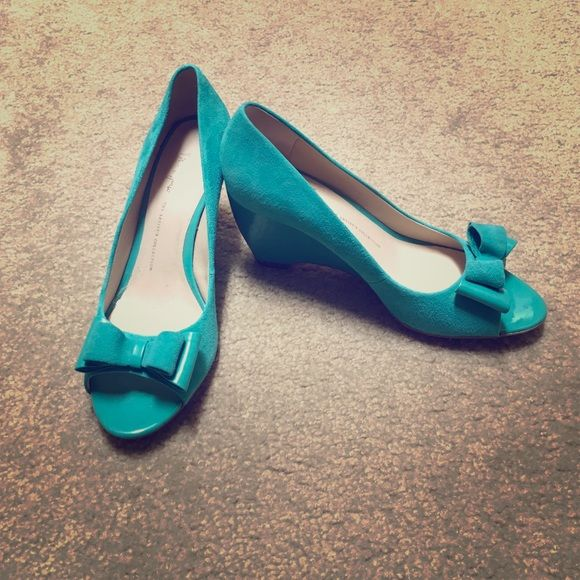 Franco Sarto turquoise wedge Beautiful shoe worn once! Size 7.5. One defect that is barely noticeable as seen on photo. Franco Sarto Shoes Wedges