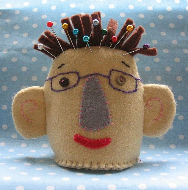 LOVE this pin cushion! Wonder if you can make it look like someone you know!
