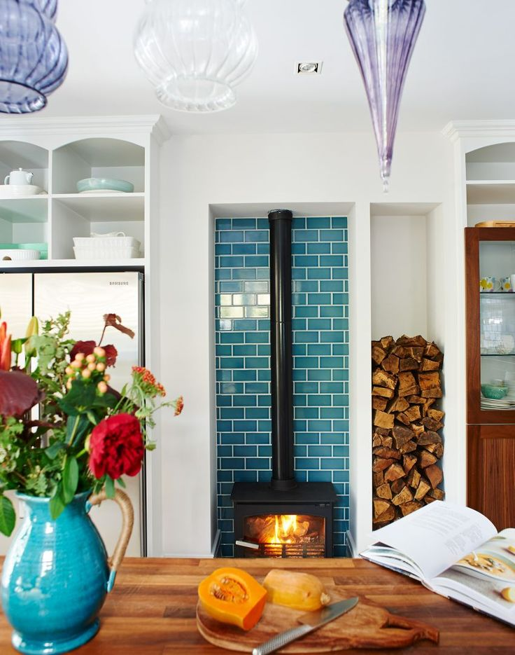 White Modern Kitchen with Blue Tiled Alcove and Woodburning Stove