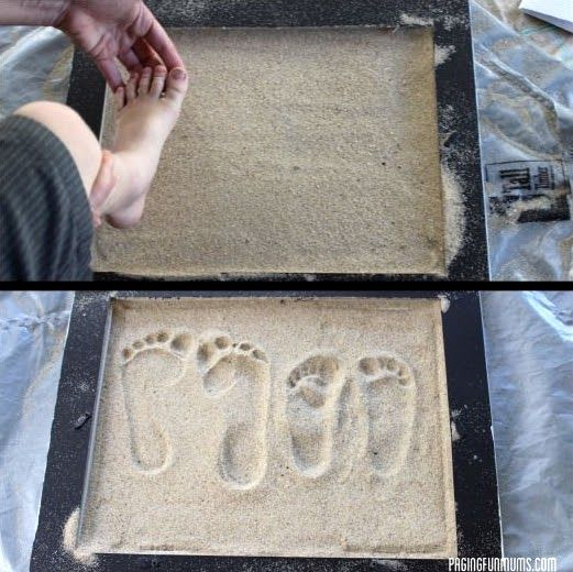 Footprints in the sand. I'd want to do this with paw prints