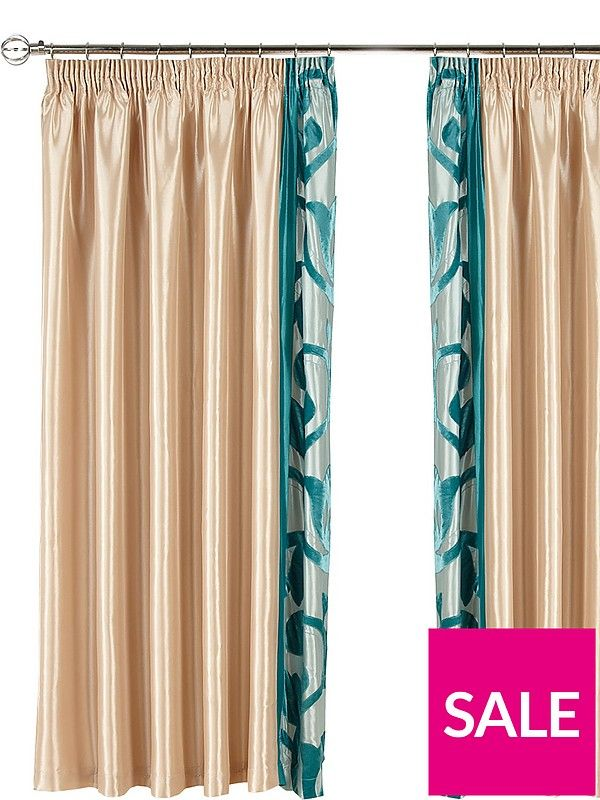 Lavina Lined Pleated Curtains with Matching Tie-Backs in TealThese Lavina curtains are made from a shiny, light-catching fabric and flaunt breathtaking panels of teal floral that stand out brilliantly next to the larger gold-toned sections. They come complete with matching tie-backs, so you can fully open them during the day to allow more natural light to enter the room.The pleated header can be hung from a curtain track or pole. Pair fits rail width up to 229 cm (7 ft. 6 inch). Single…