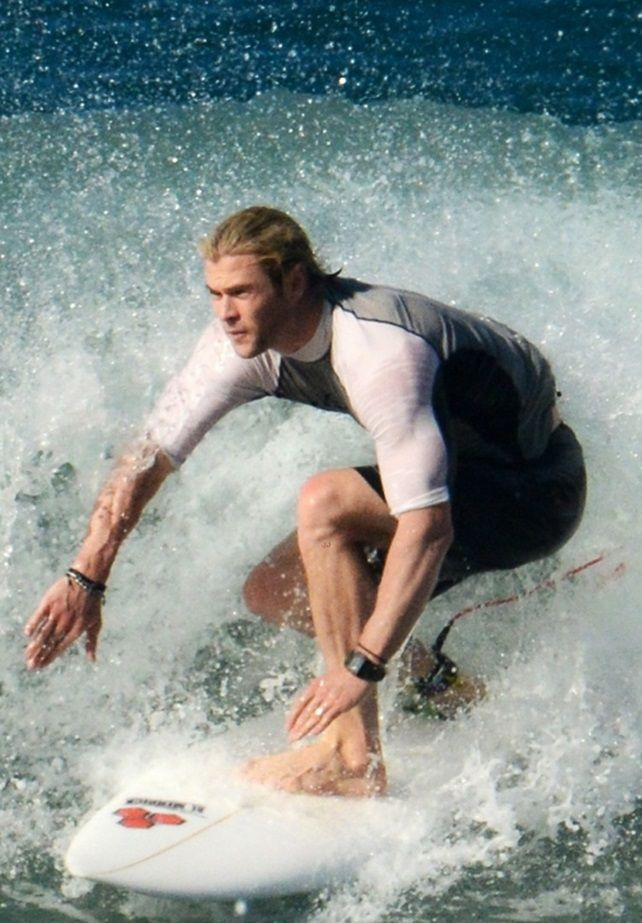 oh my...Chris Hemsworth surfing...I don't even know what bored to pin this too! #thestruggleisreal