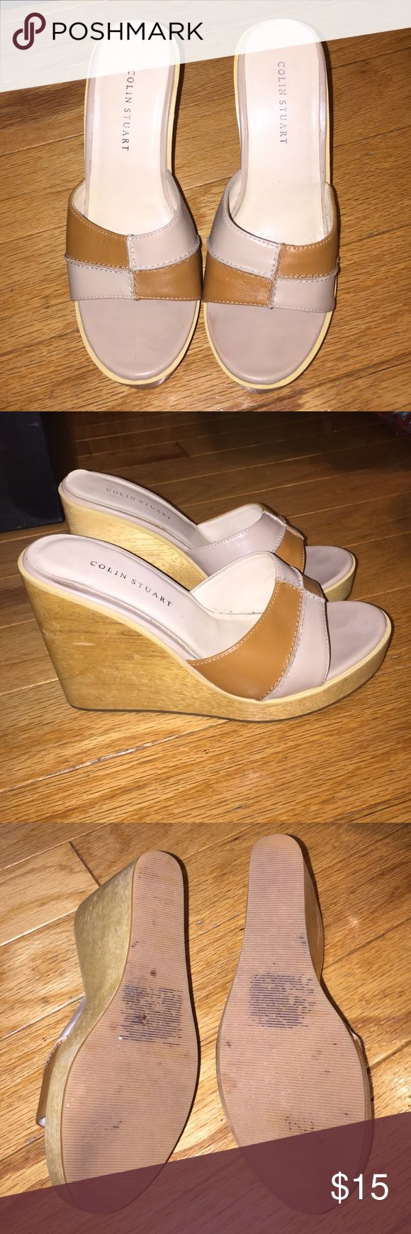 Colin Stuart Wedge Sandals - Size 6.5 Gently used Beige & Brown Colin Stuart Wood Wedge Platform Sandals in size 6.5. Only worn a few times. Photo of bottoms included and show limited wear and marks where original sticker was. Last picture shows one area on heel with slight lift to leather. Loved these for but post-twins not my size anymore. Please reach out with any questions. Colin Stuart Shoes Wedges