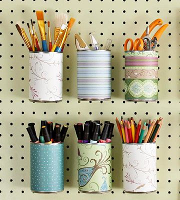 for hayden's crafty stuff... markers, paint burshes...  Design your own labels: print some of my favorite photos! Or type what belongs in the can.  Paint the cans or Covered Cans  Paper-covered soup cans hold markers, pencils, and brushes. Punch a hole in the back of the can to hang.