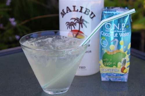 1 part Malibu Rum & 2 Parts Pineapple Coconut Water - light, refreshing summer drink