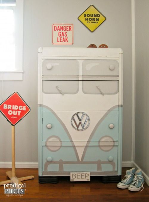 DIY VW Bus Bureau Tutorial from Prodigal Pieces.This DIY VW Bus Bureau was made from a beat up Art Deco waterfall style bureau that likely could never be restored.The VW Bus Bureau has drawer pull windshield wipers and a VW emblem found on EBAY.Prodigal Pieces also made this holiday version of the VW Bus Bureau to be auctioned off here.