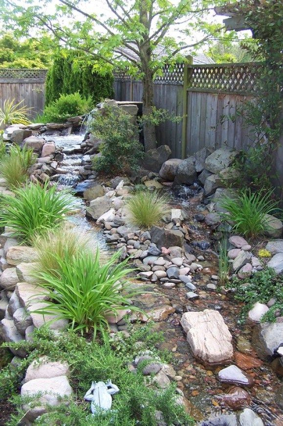 This stream was created as a lawn replacement and to conceal the sound of the neighbor's heat pump. A stream running through your backyard can also add a calm, rustic ambiance, and listening to the sound trickling water can be a good way to relax. Photo by Gary Braun of Braun Landscape