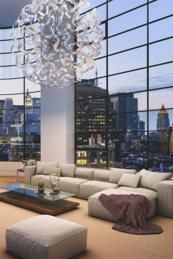SOFAS IDEAS | An apartment in penthouse with an amazing view. White big sofa with chaiselong | www.bocadolobo.com | #modernlivingroom
