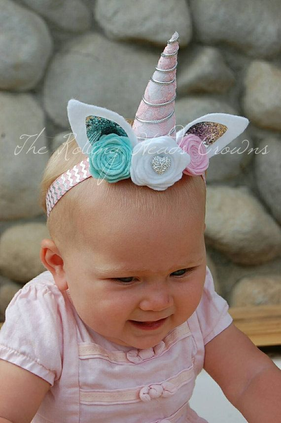This baby unicorn headband is simply adorable! The horn is adorned with lace and trim and each flower is hand rolled. This listing is for the