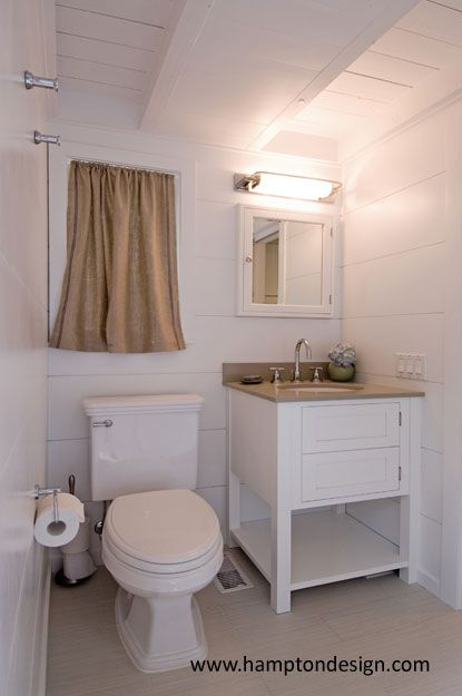 small basement bathroom, white and neutral