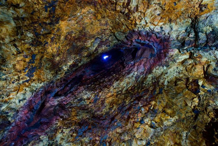 Inside the volcano: The rainbow coloured roof of the magma chamber seen from the bottom of the Thrihnjukagigur volcano in Iceland