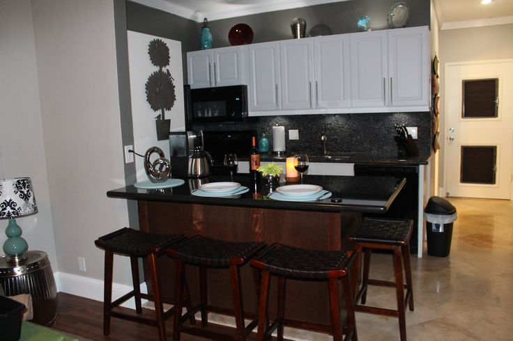 New kitchen with granite top island that seats four