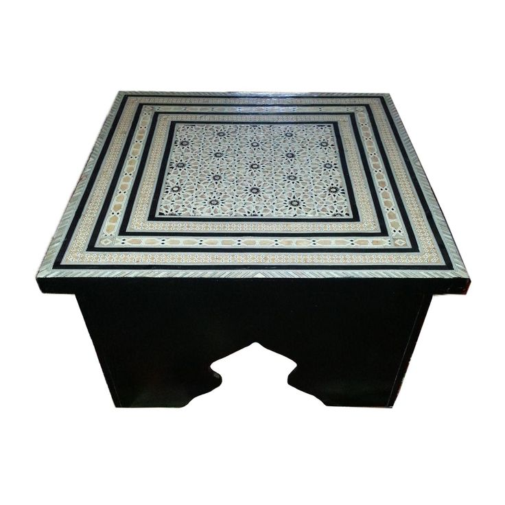 Square Moroccan coffee table. Sides are pine painted black. Top is entirely covered in mother-of-pearl design in black, beige and white.