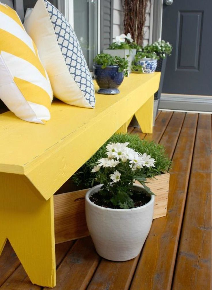 i love the idea of adding a bright wood bench to my front porch.