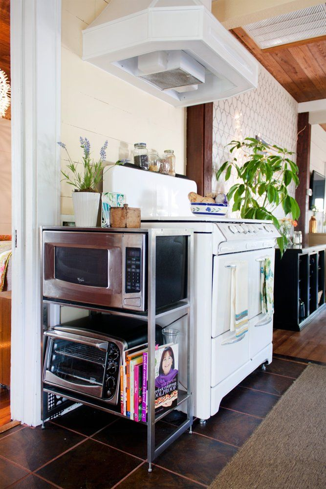 Stand for microwave and toaster oven.  Kristen & Michelle's Modern Bohemian House Tour | Apartment Therapy