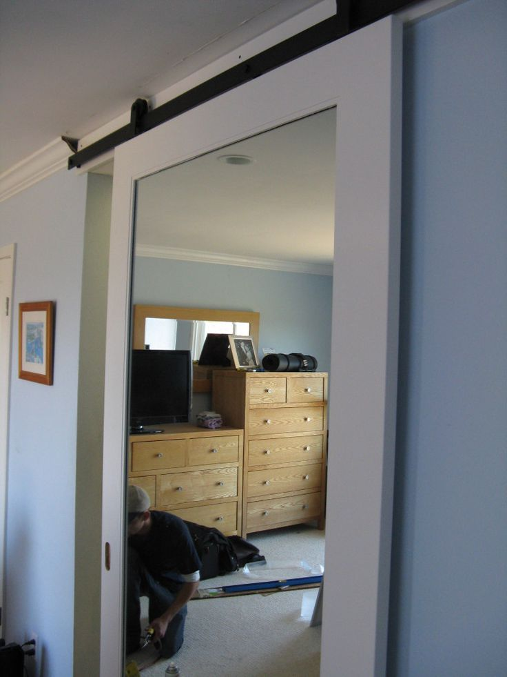 Sliding barn door mirror barn door in belmont stuff to for Bedroom closet barn doors