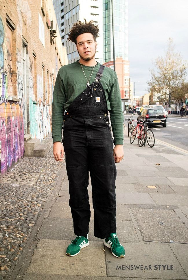 Reece on the streets of London wears Carhartt dungarees, Green long sleeve top and Green adidas trainers in 2018.