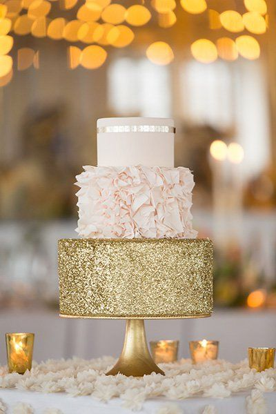 With a gold sequined bottom tier and ruffled middle tier, this chic and elegant cake has a party vibe that screams New Year.