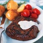 Grilled Steaks Balsamic - Flat iron steaks take a short soak in a balsamic-fig marinade, are grilled and served with an herb and garlic cheese sauce.