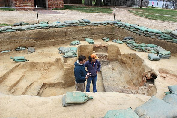 Archaeologists Mary Anna Richardson and Dave Givens stand in a dig site at Historic Jamestowne. (Photograph by Annie Fitzsimmons)