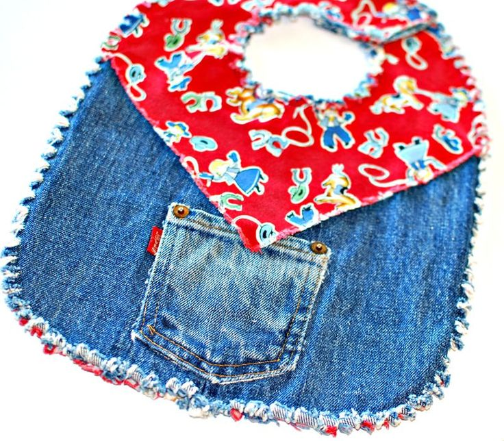 Denim Cowboy Bib - don't like the idea of pockets to catch food, but a sheriff's star would be cute.