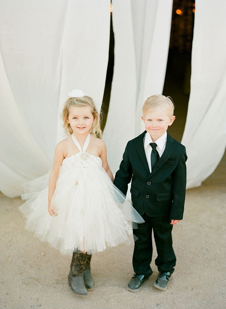Flower Girl + Ring Bearer | Photography: Melissa Schollaert Photography | See the wedding on SMP: http://stylemepretty.com/2013/04/09/scottsdale-wedding-from-melissa-schollaert-photography/