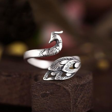 Love Peacocks? This 925 Sterling Silver Peacock Ring is perfect for you. The ring is solid 925 Sterling Silver, and is very high quality! The ring is adjustable and fits all sizes.