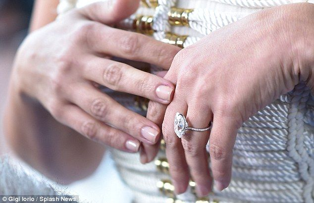 Diamonds are forever: Kim's newest engagement ring is estimated to contain a 15 carat diamond and cost around £1million
